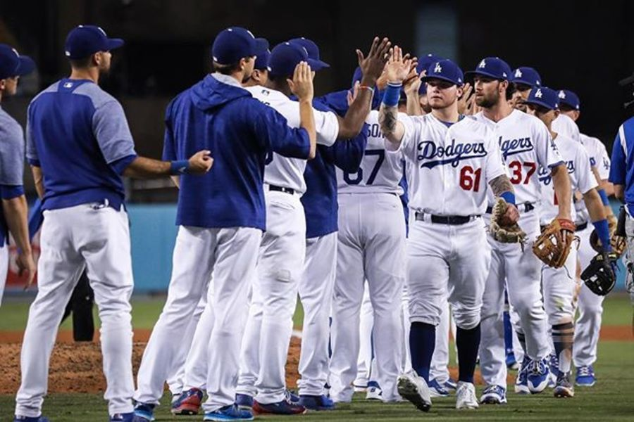 DODGERS: Players rejoice after their 9-3 victory over the Padres on September 25.