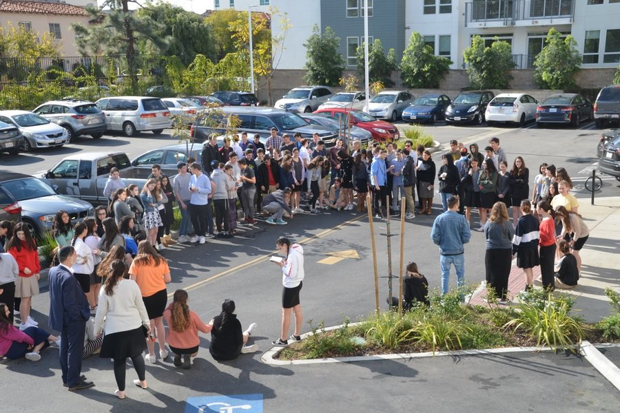 HONOR: About 90 students and faculty sang songs and read psalms in the parking lot March 14, 2018 to honor victims of the high school shooting in Parkland, Fla., that killed 14 students and three teachers. About half the school stayed in class.