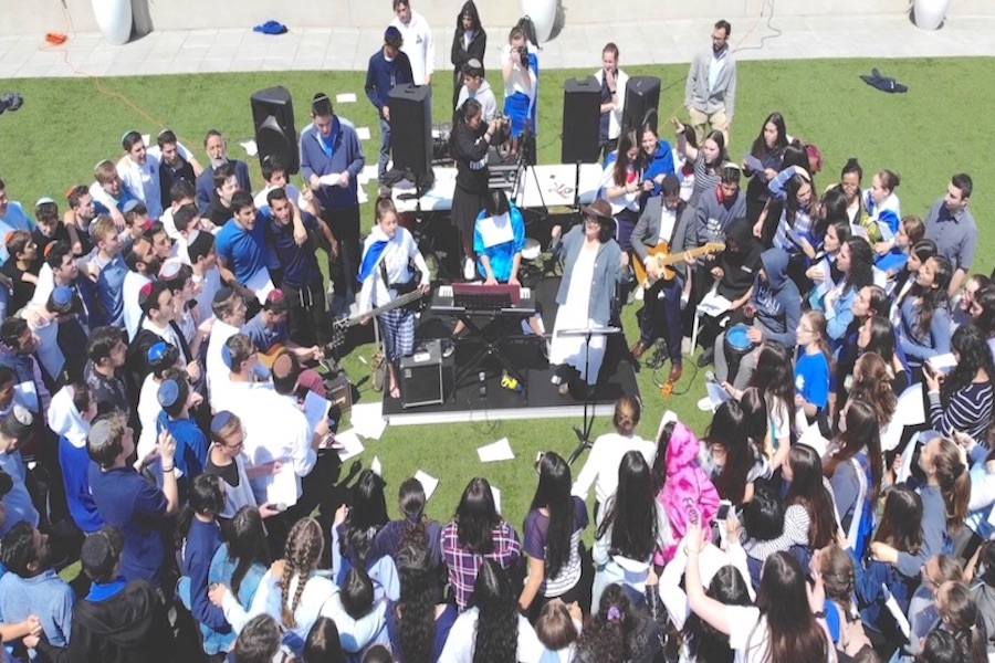 Gathered on the roof, students become a giant choir to