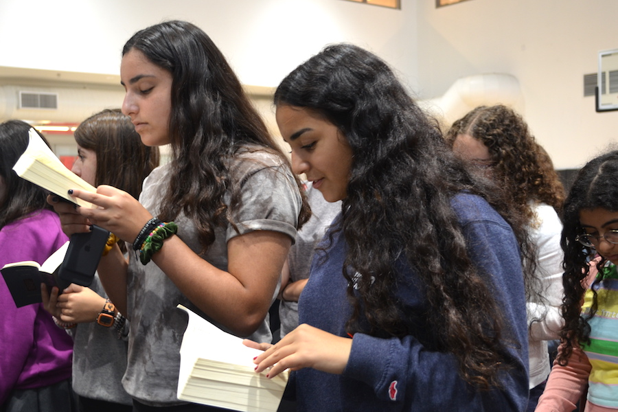 TIGHTEN:    Sophomores prayed during an all-school Shacharit in the gym. A new policy sets three levels of consequences for students who ditch.