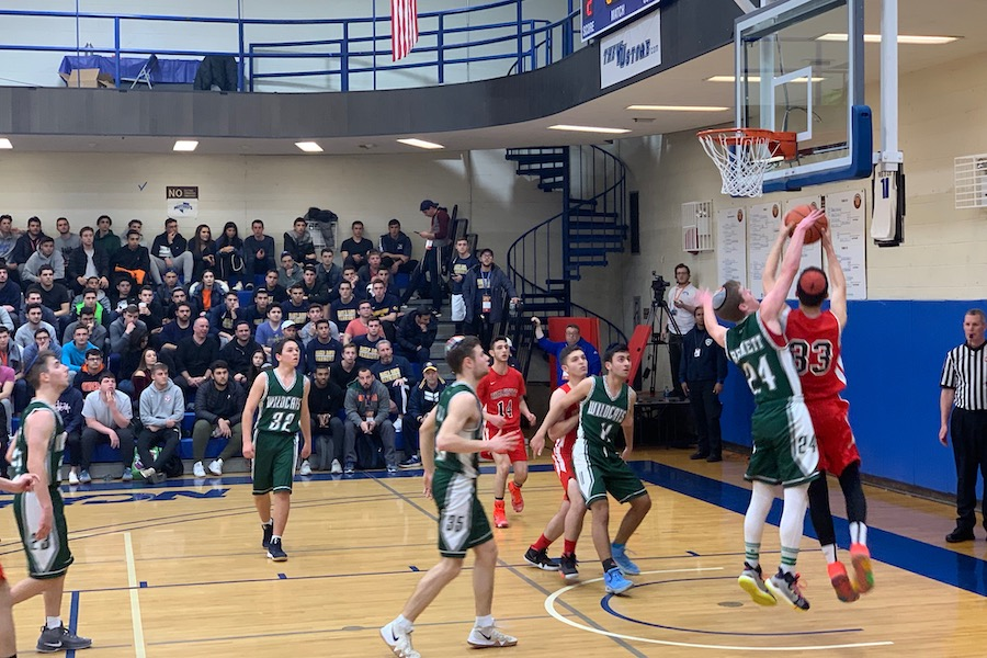 ATTACK:    ATTACK: Firehawk forward and Sarachek MVP Asher Dauer goes for a lay-up as junior A.J. Bennett tries to block it in the Firehawks' 60-41 win over the DRS Wildcats Mar. 17. The Firehawks became only the second team ever to win YU's Sarachek tournament two years in a row.