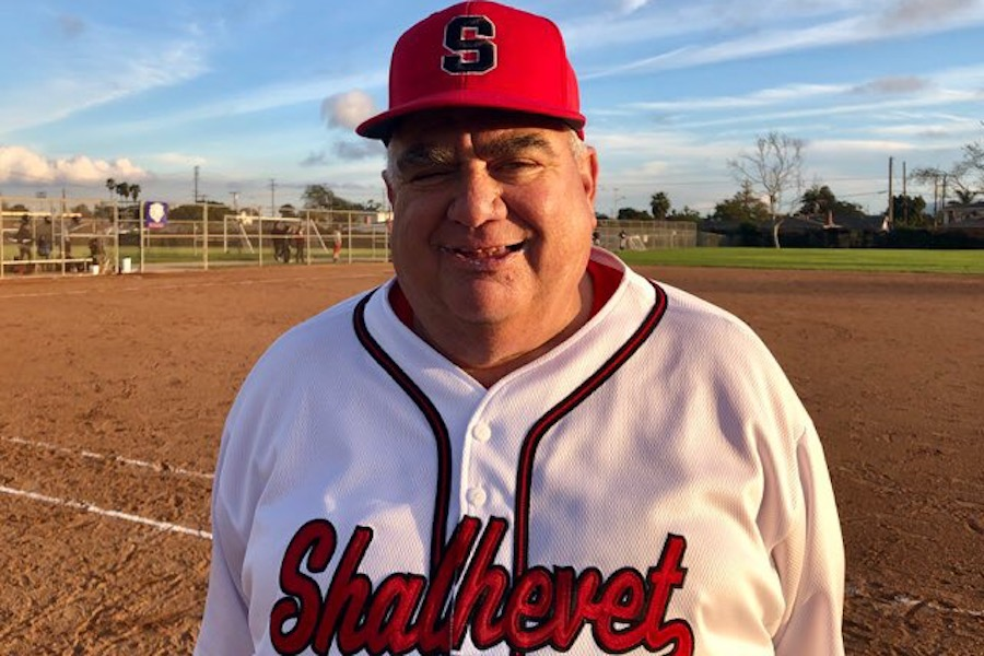 WIN:   Coach Gunches smiles for the camera following Shalhe- vet's 10-0 win over Environmental Charter Feb. 28. It was the Firehawk's first victory this season after starting off 0-2.  Photo by Alex Rubel