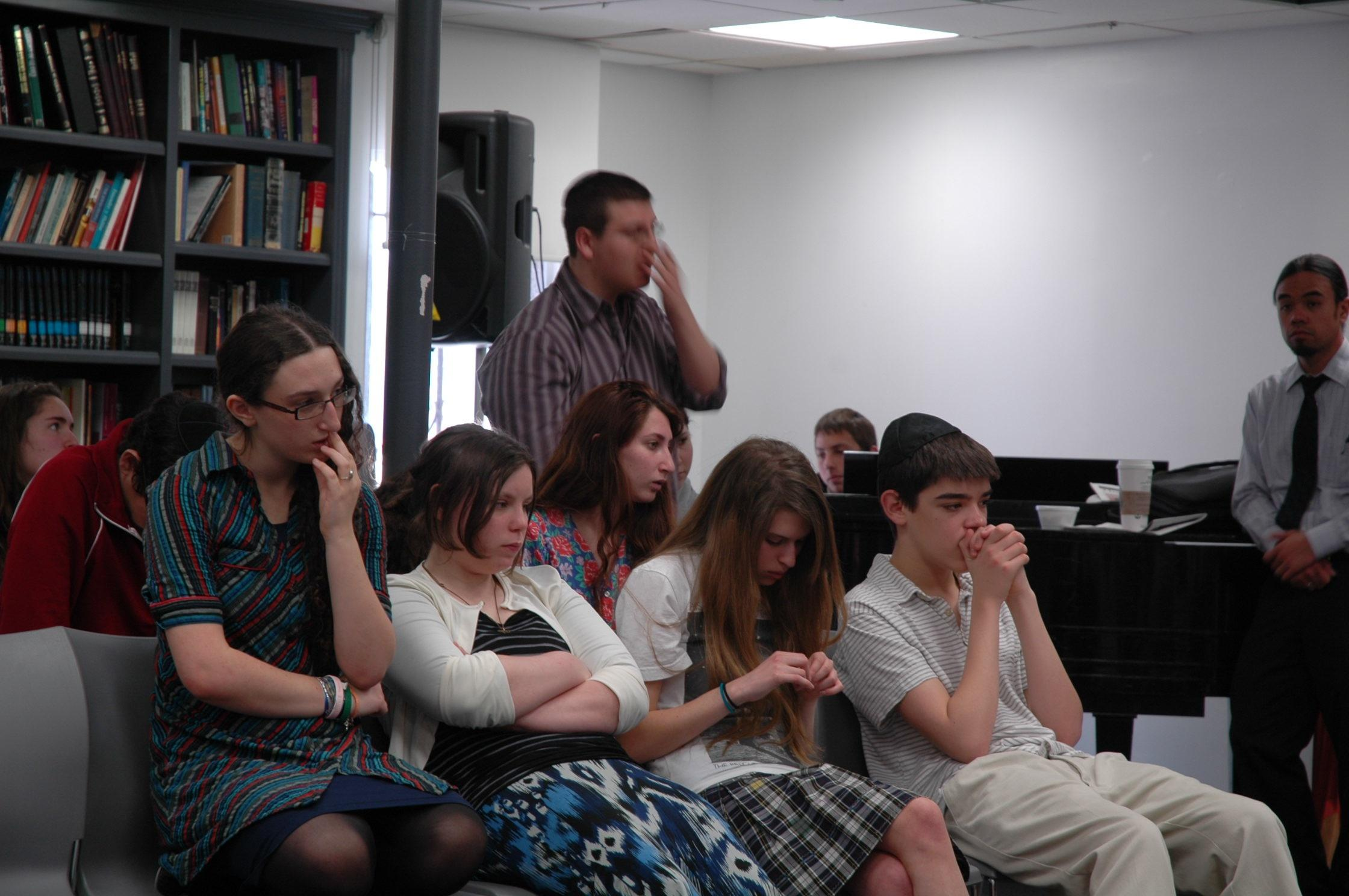 IN SHOCK: High schoolers and General Studies Principal Mr. Tranchi reacted to the news at an assembly after Shacharit.