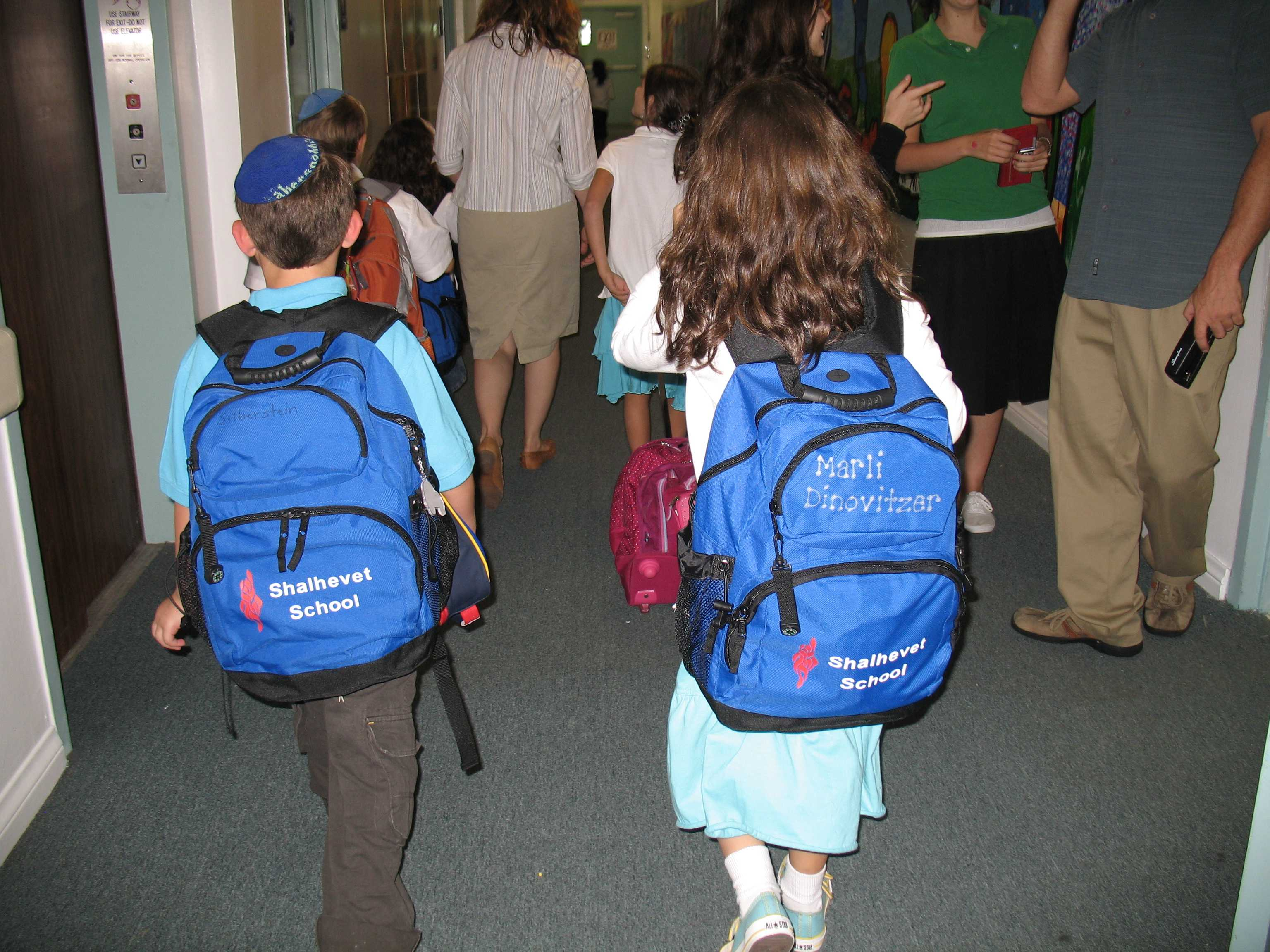 Students wearing bright new Shalhevet backpacks arrived for class the day the elementary school opened, August 20, 2005. BP Photo
