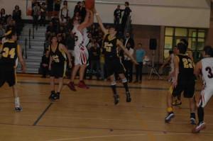 Boys varsity basketball wins league, chases YULA