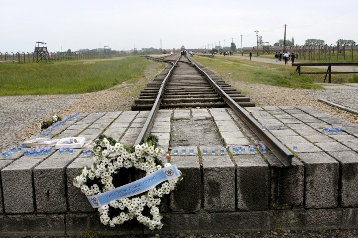 Israeli+soldiers+who+had+visited+earlier+in+the+day+laid+this+wreath+at+the+end+of+the+railroad+tracks+into+Auschwitz.++BP+Photo+by+Maya+Harel