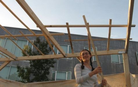 IF YOU BUILD IT... Deborah Thompson '07 building a sukkah at Brandeis last month. The Boston-area university is one of the most popular for Shalhevet alumni, and has everything Pico-Robertson has including large numbers of students observing holidays and Shabbat.