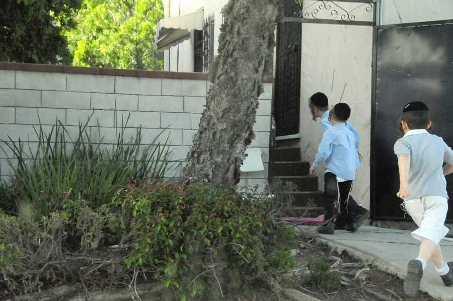 PLAYING: Young Haredi boys grow their payot long and their tzitzit out.