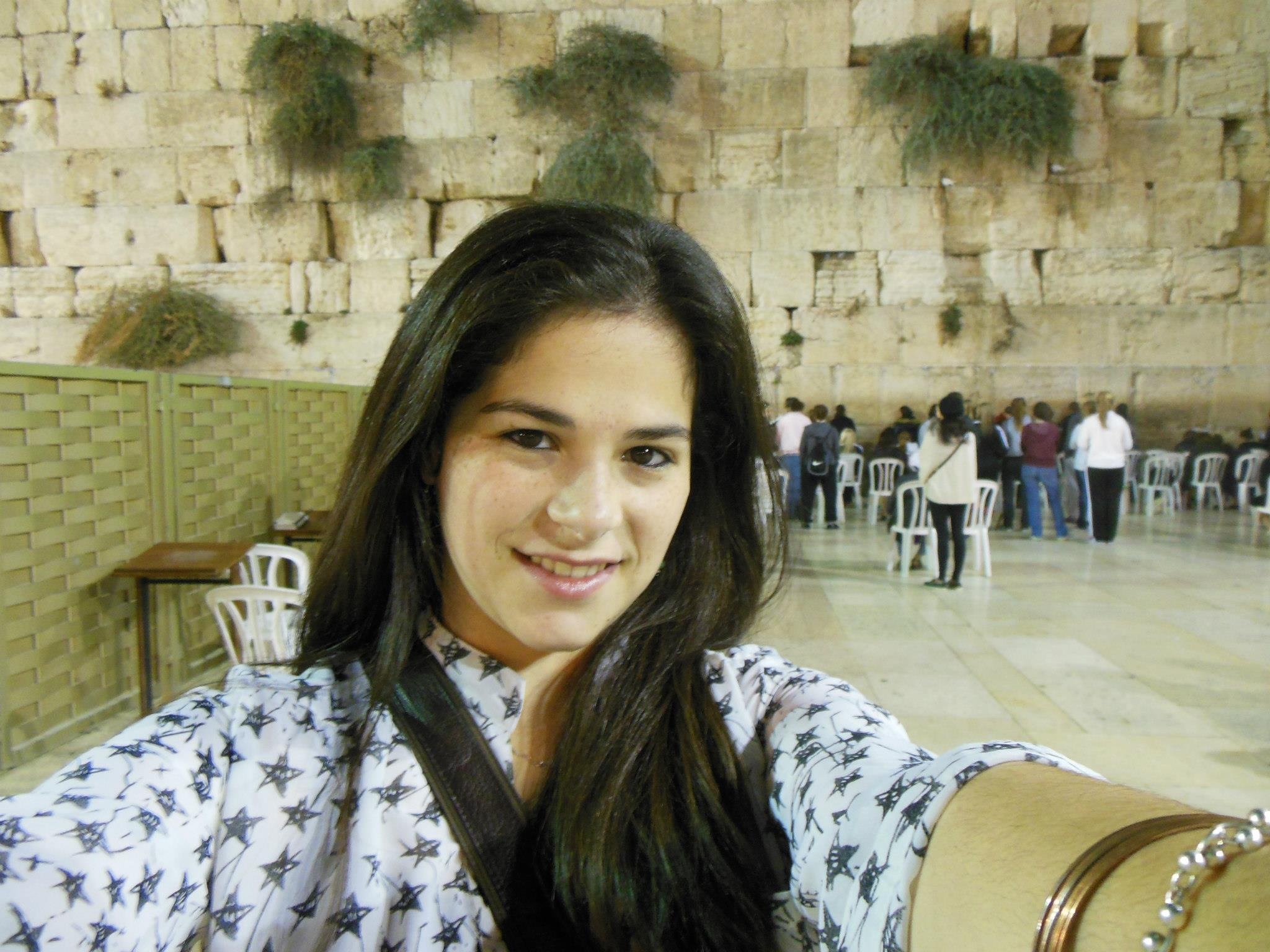 NORMAL: Ariella Joffe '12, here at the Kotel in Jerusalem, said girls at Midreshet Lindenbaum were discouraged from going out during the Gaza war in November, but that their parents back home seemed more worried than they were.