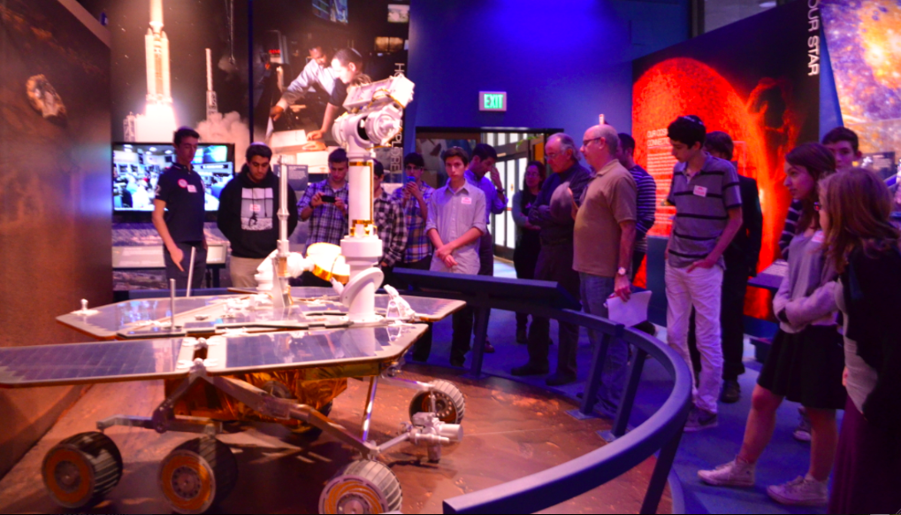 BIG DAY: Members of the Robotics Club examine replica of a lunar rover at NASA's Jet Propulsion Laboratory Dec. 4. Approval of the next Mars rover were announced while they were there.