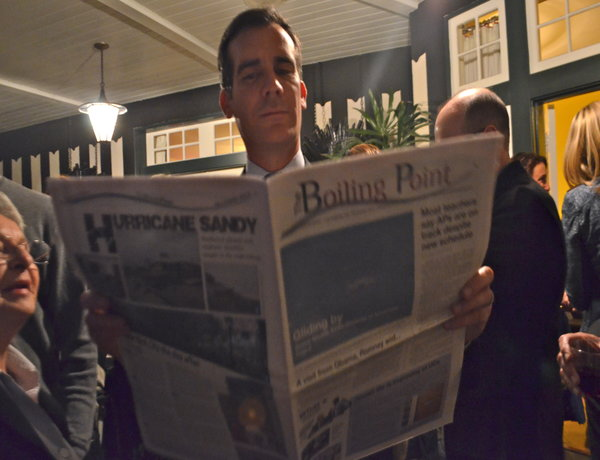 RUNOFF: Eric Garcetti, candidate for mayor, reading The Boiling Point at a private fundraiser in Hancock Park in March. Election Day is next Tuesday.