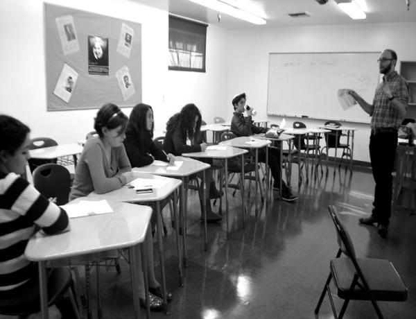 BELIEVE: Dov Rosenblatt educates upperclassmen about prayer in the singing minyan.
