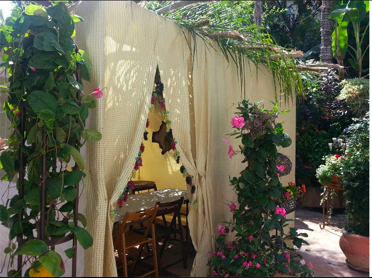 BEAUTY: Senior Yosef Nemanpour spent Wednesday putting the finishing touches on his family's sukkah, above.