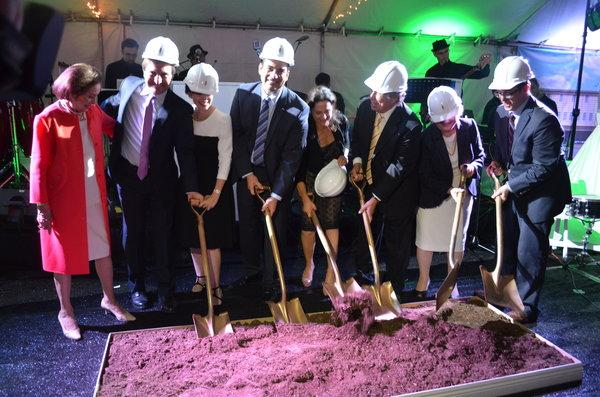DIG: The Feders, Gills, Friedmans, and Rabbi Segal wield symbolic shovels at a mock ground-breaking for the new building last June. Shalhevet's new name will be the Jean and Jerry Friedman Shalhevet High School