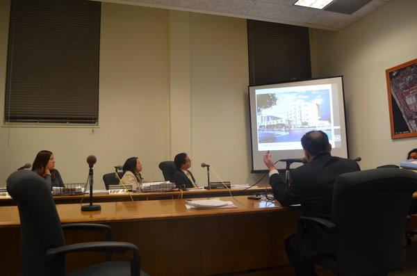 UNANIMOUS: From left, Marsha L. Brown, Chanchanit Martorell and Franklin Acevedo of Central Area Planning Commission viewed slides before voting to overturn and appeal Shalhevet's building project. the apartments shown are planned for the Southern part of the current campus which will vacated when Shalhevet moves into its new building on the Northern side.