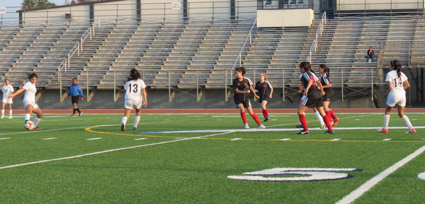 DEFENSE: Shalhevet Firehawks defend against St. Paul's High School's offensive attack.