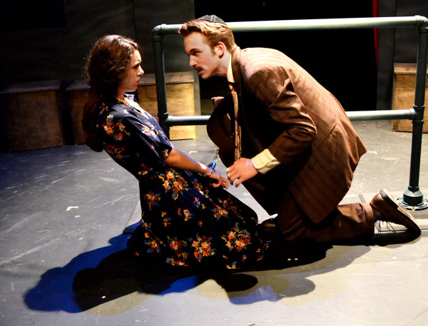 MULTIFACETED: Drama's fall play was The 39 Steps, an adaptation of Hitchcock's famous movie.  Junior David Lorell played protagonist Richard Hannes, and junior Sara Sobolev played two characters--both Richard's love interests.
