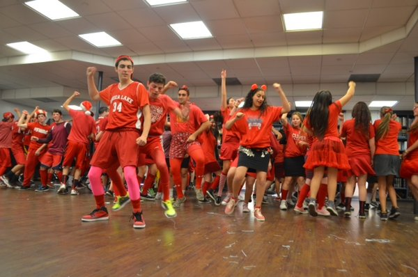 JUMP: After performing its winning song, the Red Team danced to the old classic song