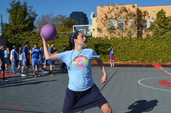 POWER: Junior Sigal Spitzer hurls the ball toward the opposing Red Team during the dodge ball game.  The Red Team beat out the Blue Team by a large margin.