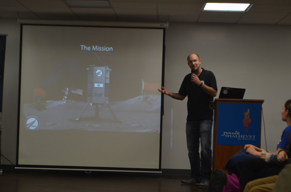 LUNAR: Yariv Bash presents his Tel Aviv-based company to students in a special assembly Jan. 29. His project, SpaceIL, aims to send a rover to the moon as part of Google's Lunar X Prize competition.