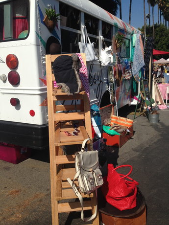 VINTAGE: Hats and purses displayed at a Melrose Trading Post booth.  The market is open every Sunday.
