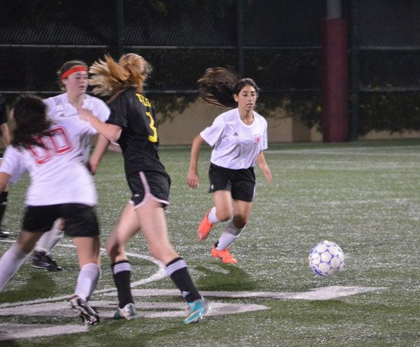 GOAL: Sophomore Dorelle Nahmany dribbles past the Lady Panthers' defense towards victory.