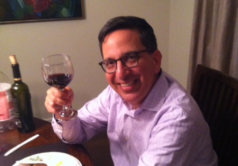 RAISE YOUR GLASS: Board treasurer Jeff Fishman drank some wine Thursday night on the day he signed papers closing the sale of Shalhevet's building to Alliance Residential.  Rabbi Segal and board president Larry Gill were out of town.