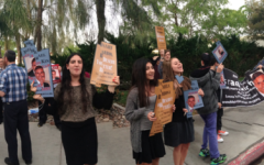 PROTEST: Sophomores Ariella Cohen, Shirin Nataneli and Natacha Chowaiki hold signs outside Meir Kin's Las Vegas wedding March 20.  Despite remarrying, he has not given his wife a get.