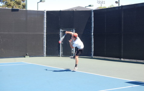 SERVED: Nathan Benyowitz serves the ball.