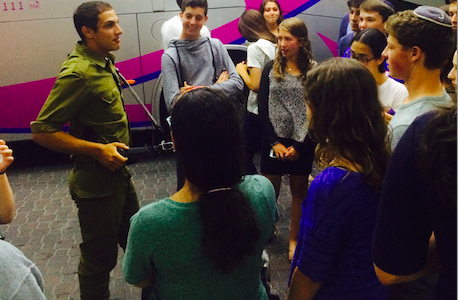 REST: An IDF soldier on leave from the fighting in Gaza addressed Bnai Akiva students in Jerusalem July 22.