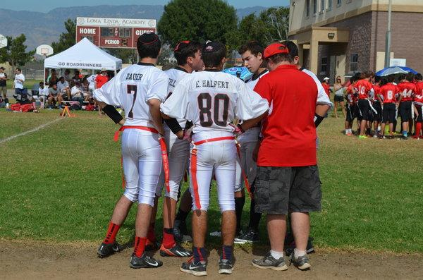 HUDDLE: During a timeout, the Firehawks huddle around Coach Buckley.