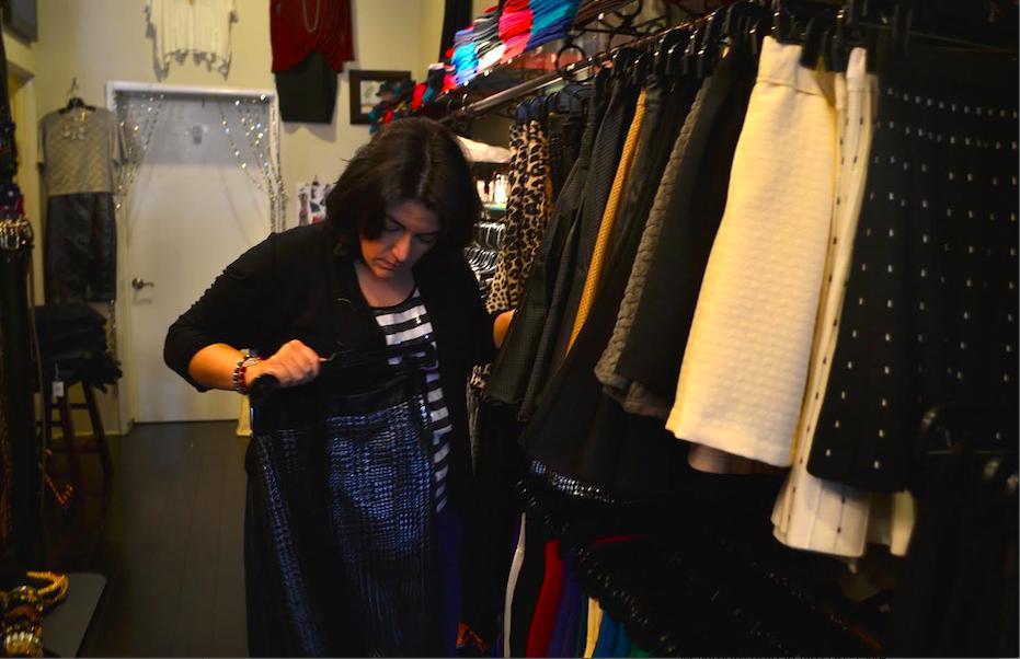 LOVE: Store owner Karen Halaszi peruses clothing meant to promote self-esteems.