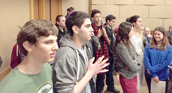 SUSPENSE: Shalhevet debaters wait to see who has won awards at Princeton Model Congress.