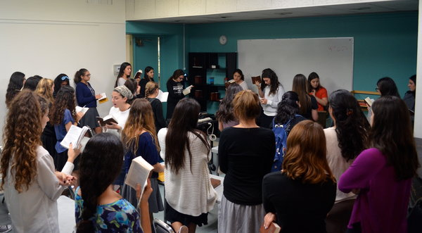 SING: Students gather daily for the girls-only singing minyan. The minyan is the largest attended at school with 59 girls.
