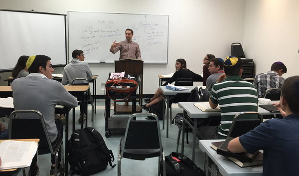 GEMARA: Rabbi Ari Schwarzberg teaches 10-12th graders during AGS, where students are learning Sanhedrin.