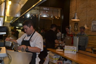 RESTAURANT: Mexikosher chef Katsuji Tanabe prepares food behind the counter for waiting customers.