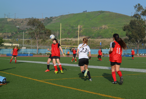 HEADS UP: Freshman Amberly Hershewe heads the ball in a 1-0 loss against YULA on Feb. 4.