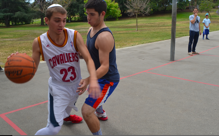 REPRESENT: Senior Firehawk basketball stars Zev Marcus and Jeremy Glouberman fight for the White and Blue teams during Color War  April 23. The first time Zev tried out, he didnt make the team..