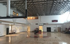 INDOOR GYM: State-of-the-art gym has a regulation basketball court and volleyball court, along with pulldown bleachers along the right-side wall and natural light pouring in from windows as long as the room.  A new Firehawk logo is on the floor at center court.