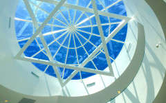 SHINE: Above the spiral staircase leading from the entrance foyer, a shallow glass dome framed with a star of David is one of many architectural features can be seen in the 26,000-square-foot new building.