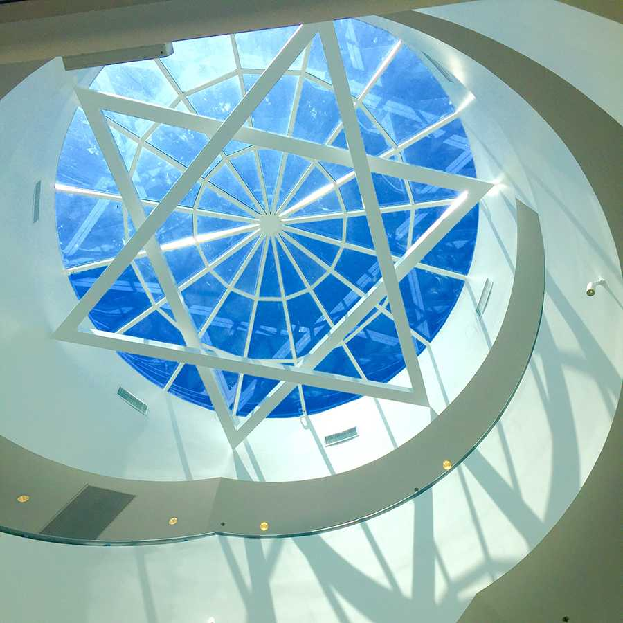 SHINE%3A+Above+the+spiral+staircase+leading+from+the+entrance+foyer%2C+a+shallow+glass+dome+framed+with+a+star+of+David+is+one+of+many+architectural+features+can+be+seen+in+the+26%2C000-square-foot+new+building.
