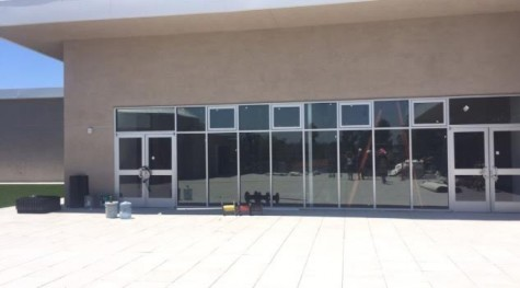 TRIBES:  Above, the Beit Midrash hosts Hashkama minyan and a 9th-10th grade minyan, while the 11th-12th grade minyan is in the Beit Knesset next door.  Twelve small windows represent the 12 tribes Below, the wooden Aron in the Beit Midrash.