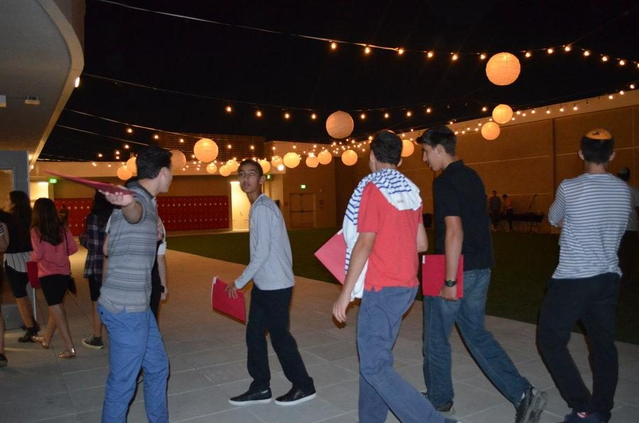 ROOFTOP: Ninth graders carrying folders with their new schedules get head to the spiral staircase to tour the building at Freshman Orientation Aug. 26.  Most of the program was held on the rooftop patio under Chinese lanterns.