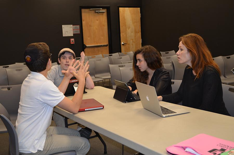 DEVISING: Ezra Fax, Eitan Schramm and Tania Bohbot work with Ms. Chase to produce two of the five one-act plays.