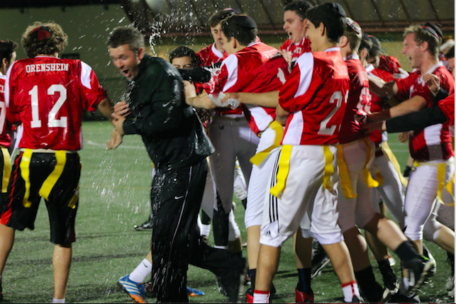 SPLASH%21+Coach+Ryan+Coleman+is+soaked+by+his+team+after+winning+the+Coastal+League+boys+flag+football+championship++Crossroads+field+Nov.+5.