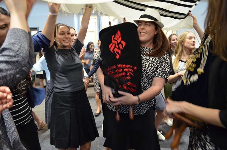 DANCE%3A+Students+celebrate+with+new+Torah+donated+by+Stacey+Kent+%28center%29+and+family+after+watching+scribe+Ronnie+Siegar+pen+the+last+three+words.