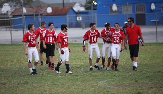 SMILES: The undefeated boys Flag Football team shared a light moment with Coach Ryan Coleman on the home field at LACES, the Los Angeles Center for Enriched Studies.
