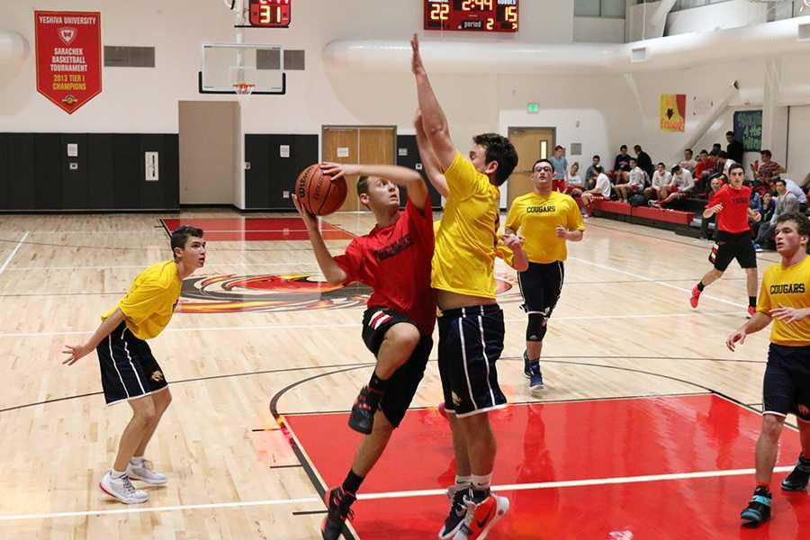 AGGRESSION%3A+FireHawk+star+point+guard+Asher+Remer+leapt+toward+the+basket+as+a+member+of+the+Berman+Cougars+jumped+to+block+him.