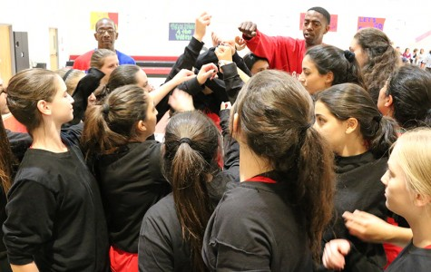 girls basketball team shared a cheer with Coach Flava before their first game at the Glouberman Tournament Nov. 12.