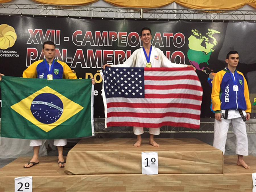 CHAMPION: Senior Daniel Soroudi accepts a gold medal for Team USA at the 17th Pan-American Karate Championships in Brazil.